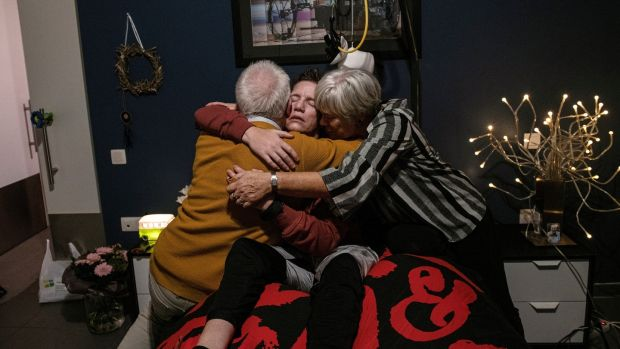 Marieke Vervoort embraces her parents, Odette Pauwels and Jos Vervoort, before her euthanasia, at her home in Diest, Belgium, October 22nd, 2019. Photograph: Lynsey Addario/New York Times