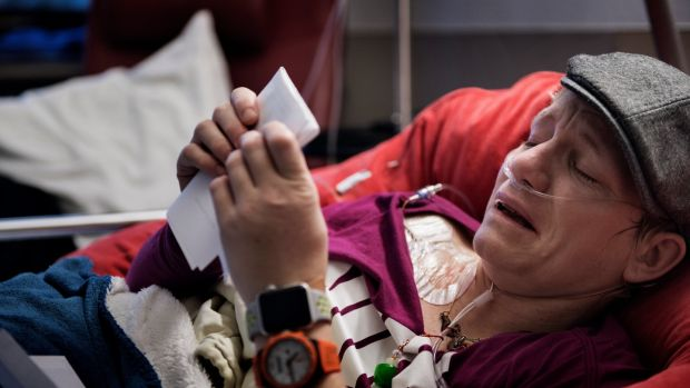 Marieke Vervoort, whose long-planned euthanasia was ultimately still more than a year away, weeps to read a farewell letter from a friend during a hospitalization in Diest, Belgium, January 2018. Photograph: Lynsey Addario/New York Times