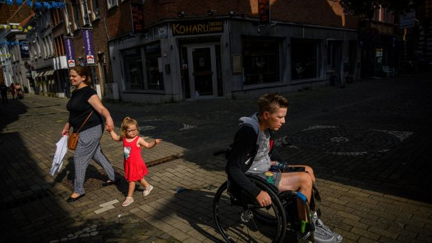 Marieke Vervoort wheels through her hometown of Diest, Belgium in the months before her death. Photograph: Lynsey Addario/New York Times