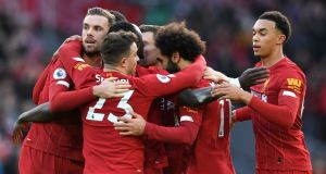 Liverpool's Mo Salah celebrates with teammates after scoring his team's first goal against Watford. Liverpool are bidding to win  their first Premier League title in 30 years. Photograph: Paul Ellis/AFP/via Getty Images