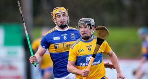Tipperary's Ronan Maher tries to chase down Clare's David Reidy. Photograph: Oisin Keniry/Inpho