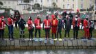 CLAUS FOR CONCERN: Scuba divers dressed in Santa suits prepare to dive into water off Sandycove Beach, Co Dublin, to raise funds for the RNLI. Photograph: Nick Bradshaw/The Irish Times