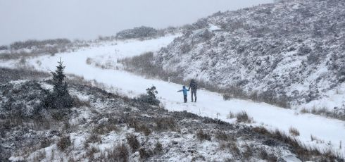 OUT IN THE COLD: People walk in the snow in the Wicklow Gap, Co Wicklow. Photograph: Niall Carson/PA Wire