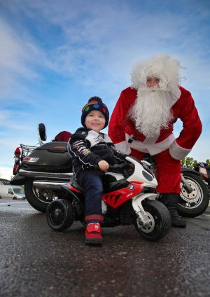 SEASONS GREETING: William Deasy meets his hero Motor Biker Santa Claus (aka Dave Foley) at the Annual Charity Christmas Bike run on the Ring of Kerry. Photograph: Valerie O'Sullivan