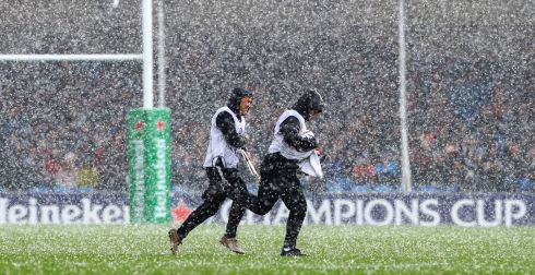 STORM IN A CUP: The match ball-boys leave the field amid a hailstorm during the Champions Cup match between Exeter Chiefs and Sale Sharks in England. Photograph: INPHO/James Crombie