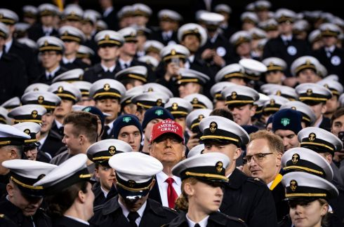 FORCE FIELD: US president Donald Trump sits with navy midshipmen during the army-navy football game, at Lincoln Financial Field in Philadelphia. Photograph: Al Drago/The New York Times