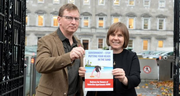 Kath Cottier, a Director of Beacon South Quarter, and Andrew Prior, an owner there, outside Leinster House, as they prepare to set up a lobbying group. Photograph: Dara Mac Dónaill