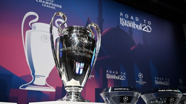 The Champions League trophy at the round of 16 draw in Nyon. Photograph: Getty Images)