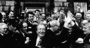 Fianna Fáil leader Charles Haughey waves to supporters outside Leinster House after his election as taoiseach in 1987. Photograph: Eamonn Farrell/RollingNews.ie