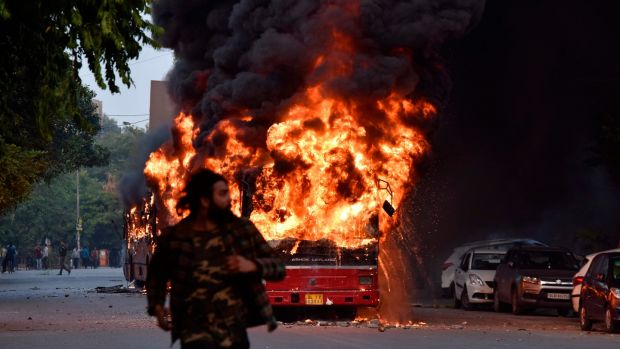 A bus ablaze following a demonstration against the Indian government's Citizenship Amendment Bill in New Delhi on Sunday. Photograph: STR/AFP via Getty Images