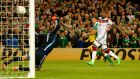 Ireland's Shane Long fizzes his shot past Germany goalkeeper Manuel Neuer. Photograph: Donall Farmer/Inpho