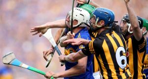 Kilkenny's Paul Murphy and Brian Hogan challenge Patrick Maher of Tipperary in the drawn All-Ireland final of 2014. Photograph: Dan Sheridan