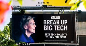 An Elizabeth Warren presidential campaign billboard. It seems like Washington DC has belatedly become alive to the undesirability of unchecked Big Tech. Photograph: Justin Kaneps/The New York Times