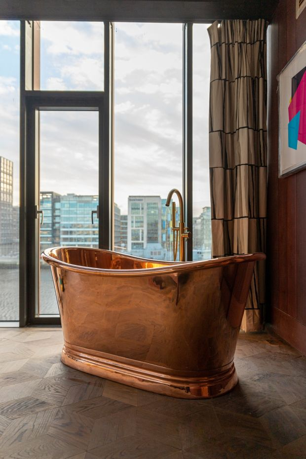 Suites have copper baths in the bedroom.