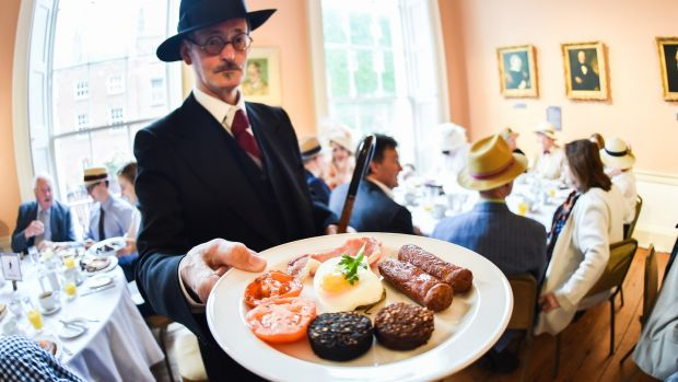 A man dressed as James Joyce takes part in Bloom's Day