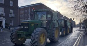 A small number of tractors are blocking St Stephen's Green in Dublin on Tuesday afternoon. Photograph: Sarah Burns