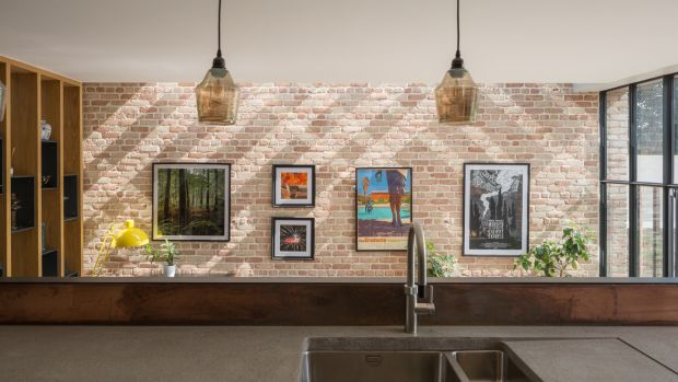 Exposed brick detail in the kitchen. Photograph: Ste Murray