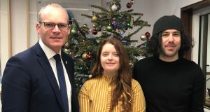 Tánaiste Simon Coveney with Emma DeSouza and her US born husband, Jake. Ms DeSouza has lodged a challenge to a ruling that those born in the North are automatically British citizens. Photograph: DFA /PA Wire