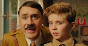 JoJo  has an imaginary friend - a dopey, goofy rubber-faced Hitler, played by Waititi himself