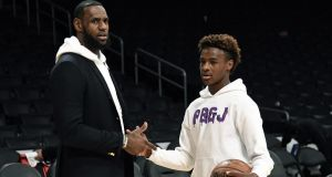 LeBron James and his son LeBron James jr on the court after the Los Angeles Clippers and Los Angeles Lakers basketball game at Staples Center. Photograph: Kevork Djansezian/Getty