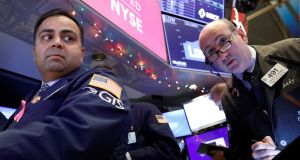 Traders work on the floor at the New York Stock Exchange: the S&P 500, which sets the tone for markets globally, passed a landmark in August as it recorded its longest rally, having gone nine and half years without a fall of at least 20 per cent. Photograph: Reuters