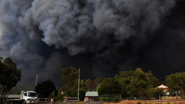 Smoke from bushfires rises into the air near Sydney, New South Wales. Temperatures above 40 degrees and strong winds are fanning a number of fires around Sydney. Photograph: EPA