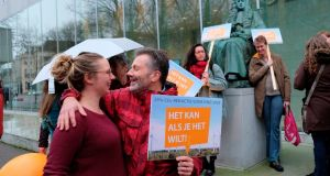 Climate activists outside the supreme court of the Netherlands in  The Hague on Friday ahead of a ruling in the landmark Urgenda case. Photograph: Mike Corder/AP