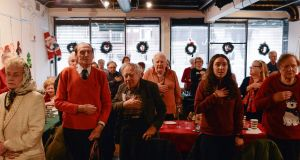 Visitors pledge the oath of allegiance at the New York Irish Center's Christmas lunch. Photograph: Lauren Crothers