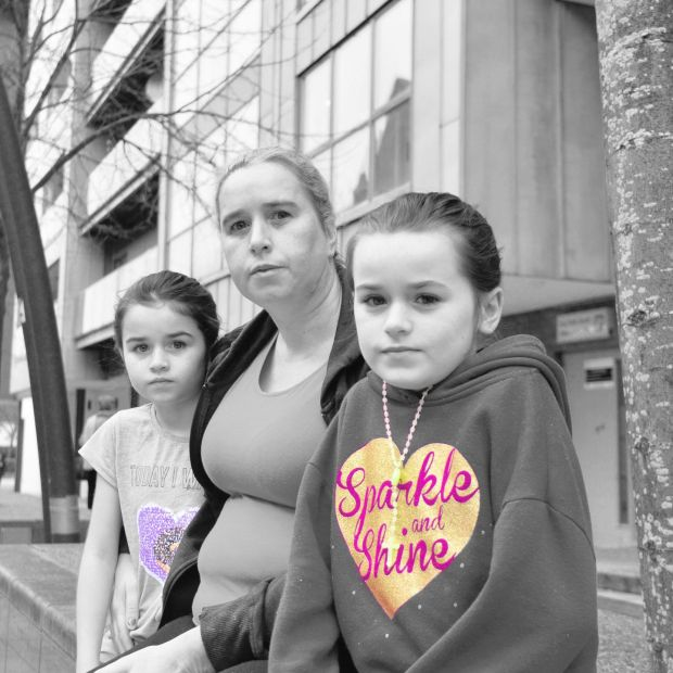 Sarah Stokes with her two of her children outside their hotel accommodation in Tallaght. Photograph: Alan Betson