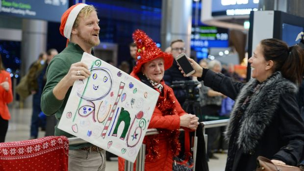 Nik Quaife welcoming Pauline Turley a friend and colleague back from New York at Dublin Airport. Photograph: Alan Betson / The Irish Times