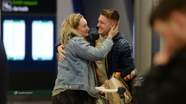 David Donnelly greeting his sister Abigail after she arrived from New York. Photograph: Alan Betson / The Irish Times