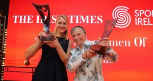 Sanita Puspure celebrates being named  as The Irish Times/Sport Ireland Sportswoman of the Year with Outstanding Achievement winner Mary Geaney. Photograph: Nick Bradshaw