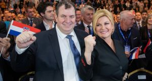 Croatia's president  Kolinda Grabar Kitarovic poses for a picture with her husband, Jakov Kitarovic, during an election rally in Zagreb. Photograph: Antonio Bronic/Reuters