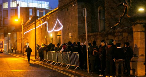 Food queue: People form an orderly line shortly after 5am for Christmas parcels. Photograph: Sam Boal/Rollingnews.ie