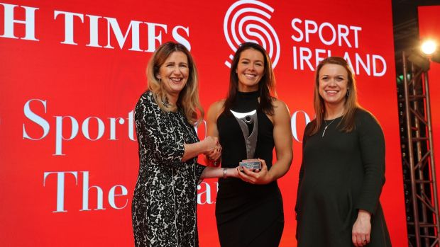 Canoeist Jenny Egan receives her monthly award for may from Deirdre Veldon, deputy editor of The Irish Times, and Lynne Cantwell, chair of Sport Ireland's Women in Sport committee. Photograph: Nick Bradshaw