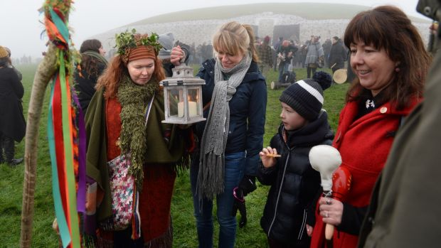 From left; Karen Ward, Ellen Shilling Dylan Ferguson and Leona Lea, all from Dublin gather outside the burial chamber at Newgrange in Co, Meath for the winter solstice. Photograph: Dara Mac Dónaill / The Irish Times