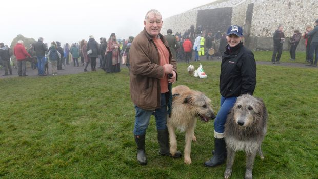 Paul and Niamh Dolan, with Irish Wolfhounds Padfoot and Maeve, outside the burial chamber at Newgrange in Co, Meath for the winter solstice. Photograph: Dara Mac Dónaill / The Irish Times