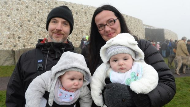David Pepper and Virginia Apicella, from Lurgan with twins Elsa and Lavinia, outside the burial chamber at Newgrange in Co, Meath for the winter solstice. Photograph: Dara Mac Dónaill / The Irish Times