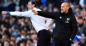 Duncan Ferguson and Freddie Ljungberg on the touchline at Goodison Park. Photograph: PA