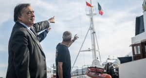 Leoluca Orlando, the mayor of Palermo,  Sicily, points at a Palermo flag he has gifted the Alan Kurdi rescue ship. 'I think what happens in Libya is a shame for the Italian government, it's a shame for the European Union, it's a shame for all European states.' Photograph: Sally Hayden