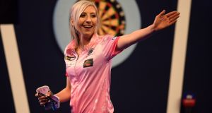 Fallon Sherrock reacts after beating Ted Evetts to become the first female to win a game in the PDC World Darts Championship.  Photograph:  Alex Davidson/Getty Images