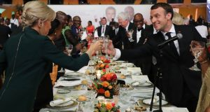 French president Emmanuel Macron  and his wife, Brigitte Macron, at a gala dinner  in Abidjan during a three-day visit to West Africa. Photograph: Ludovic Marin/ AFP