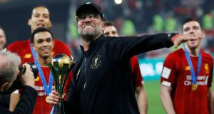 Liverpool manager Jürgen Klopp celebrates  after winning the Club World Cup in Doha, Qatar. Photograph:  Reuters/Kai Pfaffenbach