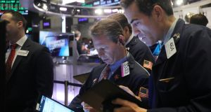 Traders on the floor of the New York Stock Exchange. Photograph: Spencer Platt/Getty Images