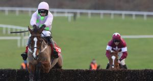 Patrick Mullins onboard Faugheen leaves Jack Kennedy and  Samcro trailing on the way to winning the the Matchbook Betting Exchange Novice Chase at Limerick. Photograph: Lorraine O'Sullivan/Inpho