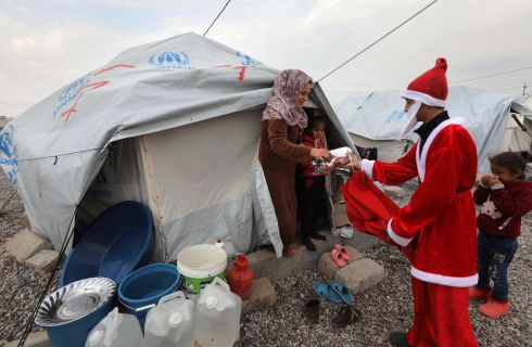 SANTA: A Syrian man dressed as Santa Claus gives gifts to children at the Gawelan refugees Camp, 40km west of Arbil, the capital of the autonomous Kurdish region of northern Iraq, on December 26th. Photograph: Safin Hamed/AFP via Getty