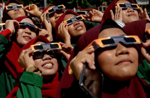 ECLIPSE: Women wearing special protective glasses observe the annular solar eclipse at mosque in Gowa, South Sulawesi, Indonesia on December 26th. Photograph: Antara Foto/Abriawan Abhe/Reuters
