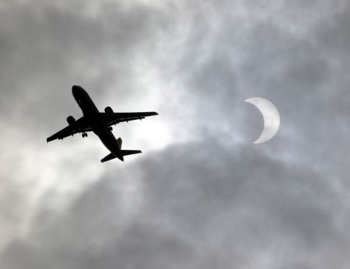 PARTIAL ECLIPSE: An airplane flies through the clouds during a partial solar eclipse seen from Noveleta town, Cavite province in the Philippines on December 26th. Photograph: Francis R Malasig/EPA