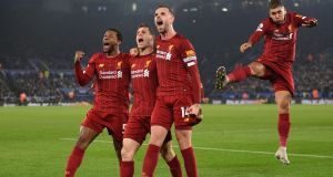 Liverpool players celebrate James Milner's goal. Photograph: Getty Images