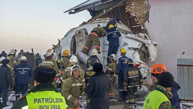 Rescuers working at the site of a passenger plane crash outside Almaty. Photograph: AFP PHOTO/Kazakhstan's emergencies committee